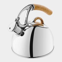 Uplift Kettle    A kitchen classic, the Uplift Kettle features heat-resistant non-slip natural cork handles. Simply lift the kettle by its handle and tilt, and the spout opens automatically for pouring. A whistle signals when the water is ready. Made by Oxo of polished high-grade stainless steel with durable zinc finishes and cork accents. Hand-wash only.