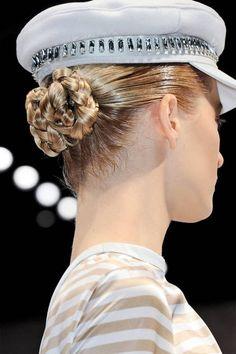 braided bun under a biker cap