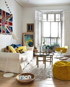 Bright living room with cool yellow pillows and funky artwork.