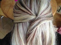 Heavy bright-platinum blonde highlights with thin dark auburn lowlights