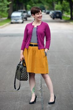 Already Pretty outfit featuring magenta cardigan, striped tank, mustard skirt, black belt, black pumps, polka dot Kate Spade bag