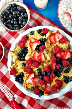 baked french toast with berries and vanilla syrup.