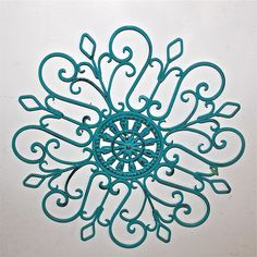 Metal Wall Fixture /Turquoise /Distressed Patio Decor /Painted Bright /Outdoor Up Cycled Iron Art /Ornate Flower Design /Beach cottage. $32.99, via Etsy.