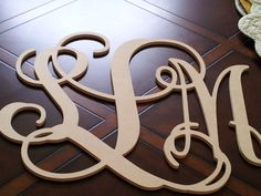 Unfinished wood monogram