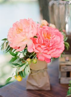 Love this Peony Centerpiece! Wedding on http://www.StyleMePretty.com/2014/03/24/elegant-picnic-wedding-with-a-fresh-color-palette/ by CherriesFlowers.com | Photography: Lisa Lefkowitz - lisalefkowitz.com