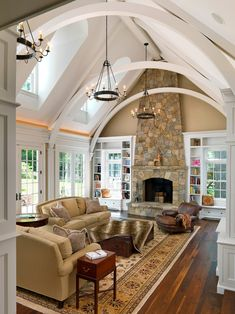 family room design, living rooms, living room designs, family rooms, high ceilings, live room, vaulted ceilings, window seats, stone fireplaces