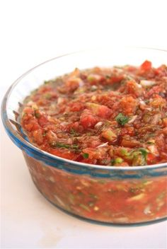 Fresh Salsa: Grill 7 tomatoes until skin is slightly charred and peeling away. Put in a covered bowl and let cool. Slide off skins. Blend coarsely: 1 tomato, 2 green chillies, 1/4 onion, 1 clv garlic, juice of 1/2 lime, handful coriander, 1/2 t oregano. Chop the remaining tomatoes and fold into the mix. Season to taste with S+P.