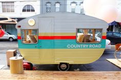 Country road vintage camper with stripes