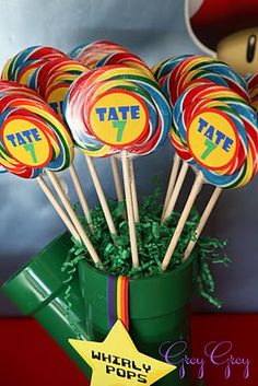Super Mario Brothers Party Idea: Spray paint a PVC pipe green and use foam to hold rainbow pops or Mario character cutouts dowels. i need this because sawyer wants a mario birthday!