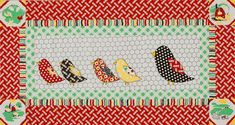 A chicken-wire print background and appliqués in feed sack reproductions combine in a cute kitchen wall hanging.