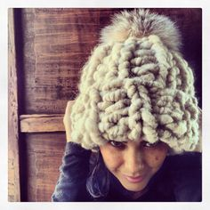 Super chunky beanie hat with very large fox pom pom on Etsy, $225.00