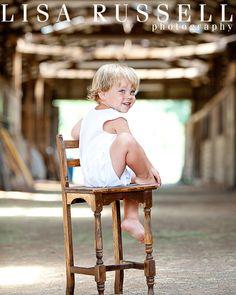 Sweet little boy in a barn on a farm at Lake Guntersville, Alabama famili, lake guntersvill