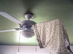 """I have a new trick for dusting ceiling fans. I used an old pillowcase. I got it damp, wrung it out really well, and covered and wiped one blade at a time with the case"""