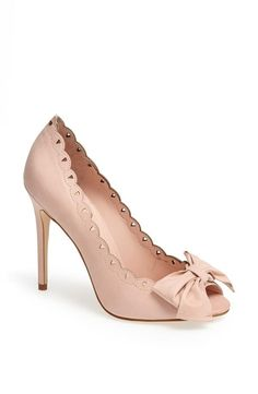So pretty. Perforated pink pump with bow