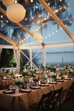 A clear tent, delicate lighting and a lakeside view made for a romantic reception. Photo by Kent Bristol Photography