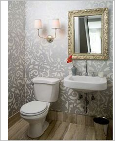 Powder room - I'd prefer a vanity/cabinet of some kind rather than the wall mounted sink. Counter space is important! Love the rest though.