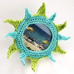 Crocheted brooch in a form of sun by Julia Kolbaskina, via Flickr