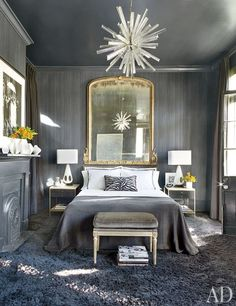 An all-gray bedroom in New Orleans features a vintage glass chandelier.