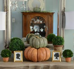 Boxwoods & Pumpkins.  A touch of Fall!