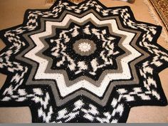 Ravelry: CottonCandees' Eric's Round Ripple baby afghans, rug, star afghan, crochet star, crochet patterns, yarn
