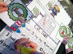 Tons of literacy activities using a bingo dabber... like this one, pick a card, dab the CVC word that matches the picture.