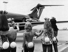 Playboy bunnies wave as Hugh Hefners private jet arrives in London. 1970s