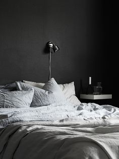 black wall bedroom, grey linens
