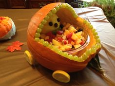 Baby shower fruit bowl made from pumpkin, lemons, grapes and cantaloupe.