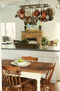 love the idea of hanging pots and pans