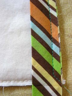 > Binding. Sew off at 45 * and how to sew inside og mitred corners.