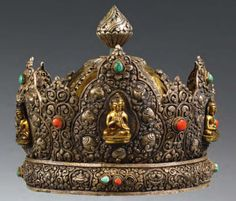 """""""Eastern Tibetan copper priest's helmet with a silver repoussé tiara, decorated with 5 copper Jina Buddah figures within aureoles. The helmet has four attached figural silver motifs and a silver repoussé top. Stone inlays. c. 1900 or earlier."""""""