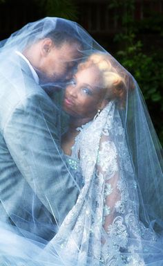 african american bride and groom veil, silver dress