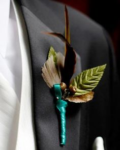 A boutonniere of silk acorns, leaves, and feathers by Brown Paper Design. via marthastewartweddings.com