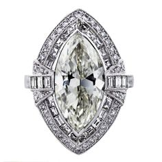 art deco engagement ring, art deco style, marquise engagement ring