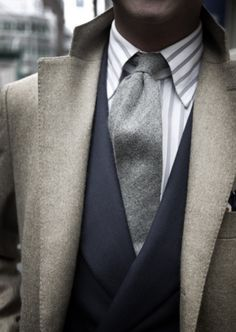 Grey wool tie, Navy jacket and a Striped shirt. Dress for success and the interview.