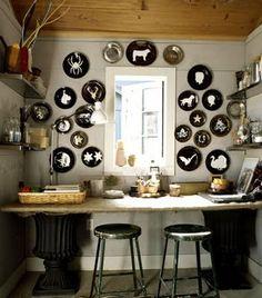 white silhouettes on black plates