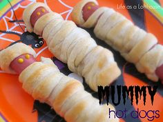 Mummy Hot Dogs. 10 large Hot Dogs  1 can (8 oz) refrigerated Pillsbury Crescent Roll dough  cooking spray  Mustard and Ketchup