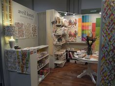 Avril Loreti - Simple booth lets the colorful products shine!