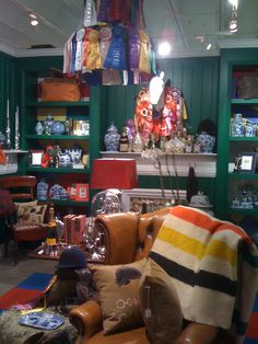 Could you see this equestrian themed design showroom as a cozy barn office or lounge? Swap out the china for trophies and I could!