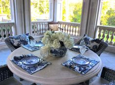 Setting a blue and white chinoiserie table al fresco style……
