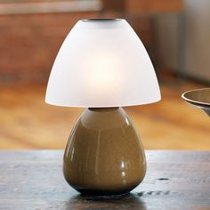 """SAHARA SANDS™ LAMP Stoneware lamp with a beautiful Sahara Sands glaze and frosted glass shade. Neutral design works with any home décor. Includes glass votive cup. 11"""" h, 7 1/4"""" diam."""