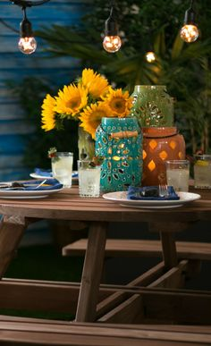 Keep your outdoor party going after the sun goes down with string lights and fun lanterns! And of course, no party table would be complete without flowers. :-)
