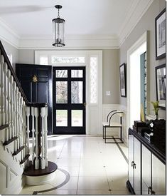 Classy black, white, and gray (Benjamin Moore REVERE PEWTER;Trim:  Benjamin Moore WHITE DOVE) entry from (C.B.I.D. HOME DECOR and DESIGN