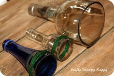 cut glass bottles with cotton yarn and nail polish remover
