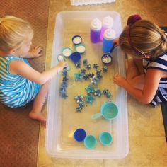 Frozen Glitter Stars Sensory Play frozen stars, salt, scoops, squeeze bottles, make for fun playing and mixing in the sensory tub