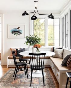 Modern built-in breakfast nook with banquette seating - design by Casey Keasler