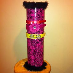 """I plan on making some of these for my """"girls""""..... Headband holder ( made out of 2 oatmeal containers, duct tape and boa)."""
