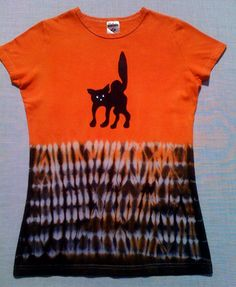 How to create this chic, spooky, Halloween T-shirt using a dyeing technique known as Shibori, a Japanese term used to describe several methods of dyeing cloth with a pattern by binding, stitching, folding, twisting, compressing or capping. These Ts are perfect for kids or adults.