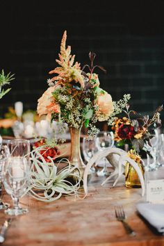 a great mix of airplants + fall inspired florals and antlers  Photography By / markbrooke.com, Floral Design By / hollyflora.com, Wedding Coordination By / orangeblossomspecialevents.com