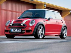 BMW Mini Cooper - cute little British looking car - kind of expensive - starts at 20,000. but the average m.p.g. is 35.  The new Countryman has 4 doors!